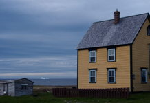 Saltbox house and an iceberg