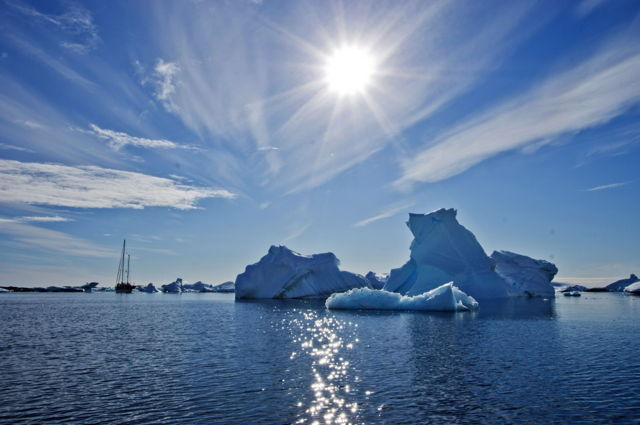 Antarctica - Iceberg and Sailboat