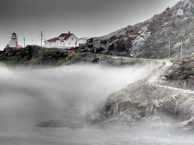 Fog rolling by Fort Amherst