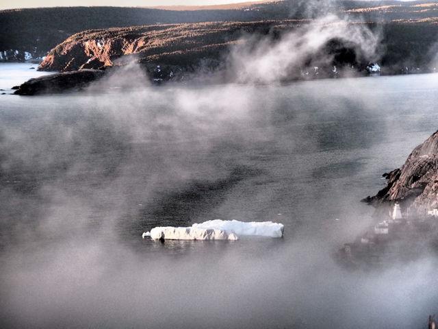 Iceberg through the fog