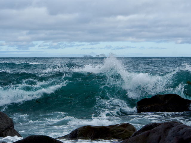 Wave and iceberg