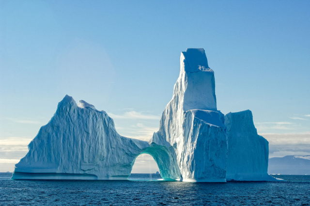 Arched Iceberg with Waterfall, Disko Bay, Greenland